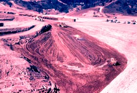 The hilly land required extensive grading and leveling, along with cement for the paving of service roads and parking lots.