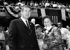 Kay O'Malley throws out the ceremonial first pitch on Opening Day 1962. The First Lady of the Dodgers was the perfect choice to throw the pitch, as she was an enthusiastic baseball fan and kept score of every home and road game. Standing next to Kay is son Peter, who became President of the Dodgers on March 17, 1970.