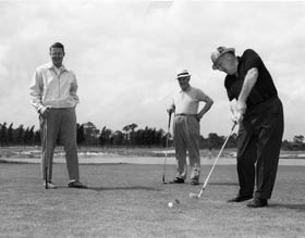 Golf became a passion for Walter O'Malley in the 1960s. The Dodger President hits his tee shot while Peter O'Malley and Vice President Fresco Thompson look on.
