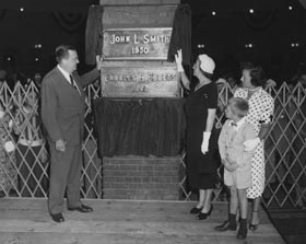 Walter O'Malley unveils a plaque saluting the memory of Dodger stockholder John L. Smith, who passed away on July 10, 1950.