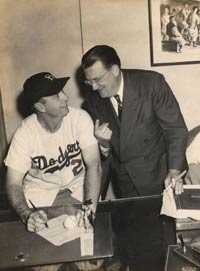 Walter O'Malley congratulates new Dodger Manager Walter Alston at his first contract signing on Nov. 24, 1953.