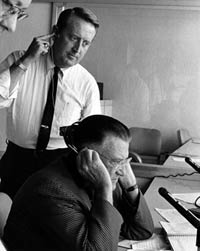 Popular Dodger broadcaster Vin Scully is in the broadcast booth with Walter O'Malley in 1972. Scully's first season with the Dodgers was in 1950 and he completed his 54th season in 2003. He entered the National Baseball Hall of Fame as recipient of the Ford C. Frick Award in 1982.
