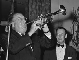 "Walter O'Malley borrows a trumpet from a musician and toots on it at a postgame party at the Hilton Hotel to celebrate the Dodgers' 1959 World Series title in Chicago on October 8. The Dodgers defeated the ""Go-Go"" White Sox, four games to two, winning the final game in Comiskey Park, 9-3."