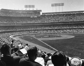 Opening Day, April 10, 1962, was a feast for the eyes, with all the anticipation of a new season and a new ballpark as Dodger Stadium makes its debut. Eddie Kasko of the Cincinnati Reds has the honor of getting the first hit in Dodger Stadium, as he doubles to left on the second pitch of the game off Johnny Podres.