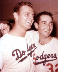 Dodger ace pitchers Don Drysdale and Sandy Koufax celebrate the 1963 World Series title. The duo formed one of baseball's all-time great pitching tandems.