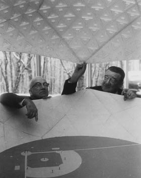 In November 1955, R. Buckminster Fuller and Walter O'Malley peer inside a model of what would have been baseball's first domed stadium, built in Brooklyn years before the Houston Astrodome opened in 1965.