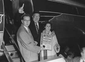 As they arrive in Los Angeles on their own airplane on Oct. 23, 1957, Dodger President Walter O'Malley steps off the plane to a welcoming committee headed by key supporters County Supervisor Kenneth Hahn and L.A. City Councilwoman Fifth District Rosalind Wyman.