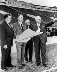 Walter O'Malley, (from l-r) engineer John Waterbury, Amos Buckley, in charge of maintenance of the Dodgers' installations and Warren Giles, National League President, reviewing plans and field drawings on Jan. 7, 1958 for the possible use of the Rose Bowl in Pasadena as a temporary home for the Dodgers, while Dodger Stadium is to be built.