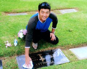 Popular Dodger closer Takashi Saito kneels in tribute to Walter O'Malley and polishes the gravestone of the former team owner on October 13, 2006. Saito also polished the gravestone and honored the memory of Ike Ikuhara, former Dodger Assistant to the President, who was a graduate of Japan's Waseda University and enshrined in the Japanese Baseball Hall of Fame.