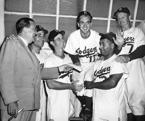 On the occasion of Carl Erskine's 5-0 no-hitter over the Chicago Cubs on June 19, 1952, Dodger President Walter O'Malley presents him with a $500 check. Joining in the exuberant celebration are Carl Furillo, Preacher Roe, Roy Campanella and Manager Charlie Dressen.