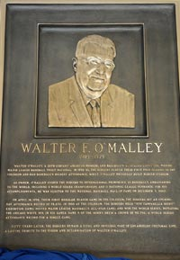 "The bronze plaque honoring Walter F. O'Malley will be displayed in the Los Angeles Memorial Coliseum ""Court of Honor"", located at the peristyle end. O'Malley's bronze plaque is the 55th that the Coliseum Commission has awarded, joining a U.S. President, a Pope, world-class athletes, dignitaries and historic events.<br /><br />Photo Courtesy of Jon SooHoo, Los Angeles Dodgers"