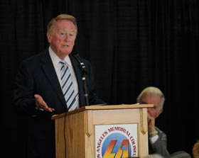 "One of seven speakers on the program, Dodger Hall of Fame broadcaster Vin Scully reminisces about his close relationship with former Dodger owner Walter F. O'Malley. Earlier in 2008, Scully was honored with a bronze plaque in the Coliseum's ""Court of Honor."" Scully spoke of his admiration of O'Malley by stating, ""He was like a second father to me.""<br /><br />Photo Courtesy of Jon SooHoo, Los Angeles Dodgers"