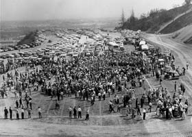 """The first ever """"crowd"""" at Dodger Stadium assembles for the groundbreaking ceremony of baseball's finest stadium during the Dodgers' 1959 September pennant race."""