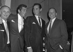 Dodger superstar Sandy Koufax (second from right) stands with entertainment giants Dean Martin (second from left) and Frank Sinatra (far right) at Hillcrest Country Club where Koufax was honored as baseball's pitcher of the year on December 4, 1963. Other performers attending the testimonial dinner, emceed by George Jessel, included Danny Kaye, Jack Benny, Phil Silvers, George Burns, Tony Martin and Nat King Cole.