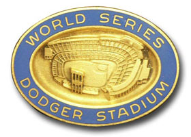 A collectible Dodger press pin from the 1963 World Series, featuring the Dodgers and the New York Yankees, showcases one-year-old Dodger Stadium.