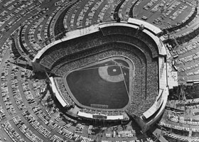 Dodger Stadium is filled to capacity for Game 3 of the 1963 World Series as 55,912 fans went through the turnstiles. In that game, the Dodgers blanked the New York Yankees 1-0 behind the overpowering pitching of Don Drysdale.