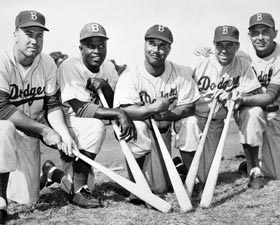 "A quintet of Brooklyn Dodgers, four of whom were eventually inducted into the Baseball Hall of Fame, made significant contributions to the game and helped shape the course of Dodger history. Shown from left to right are Duke Snider, Jackie Robinson, Roy Campanella, ""The Captain"" Pee Wee Reese (all in the Hall of Fame) and Gil Hodges."