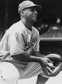 A pillar of strength, catcher Roy Campanella joined the Brooklyn Dodgers for the 1948 season following a stint in their minor league system with Nashua, NH and Montreal. As one of the first four African-Americans to be signed into Major League Baseball, Campanella was well-prepared for the opportunity having previously played in the Negro Leagues and Mexican League.