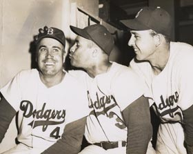 "Brooklyn Dodger center fielder Duke Snider, known as ""The Duke of Flatbush,"" receives admiration from friends and teammates Roy Campanella and first baseman Gil Hodges."