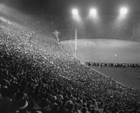"A major league record crowd of 93,103 attends the ""Roy Campanella Night"" exhibition game between the Dodgers and the New York Yankees at the Los Angeles Memorial Coliseum on May 7, 1959. Even though Campy never had played in Los Angeles, the fans wanted to salute him. Some 15,000 more fans were turned away in the sell-out."
