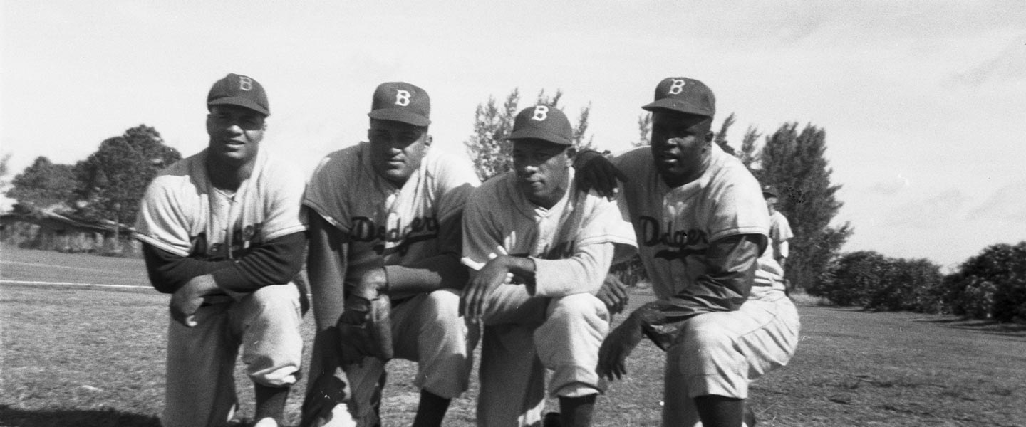 (L-R) Roy Campanella; Don Newcombe; Dan Bankhead; Jackie Robinson.  Four prominent Dodger players in Major League Baseball history are together for a photo at Historic Dodgertown in the early 1950s.  Roy Campanella won three National League Most Valuable Player Awards and was elected to the Hall of Fame in 1969; Don Newcombe is the first player to win the National League Rookie of the Year, the Cy Young Award and the National League Most Valuable Player; Dan Bankhead is the first African-American pitcher to make his debut in the Major Leagues; Jackie Robinson one of American history's greatest heroes was a 1949 National League Most Valuable Player and was elected to the Hall of Fame on the first ballot in 1962.