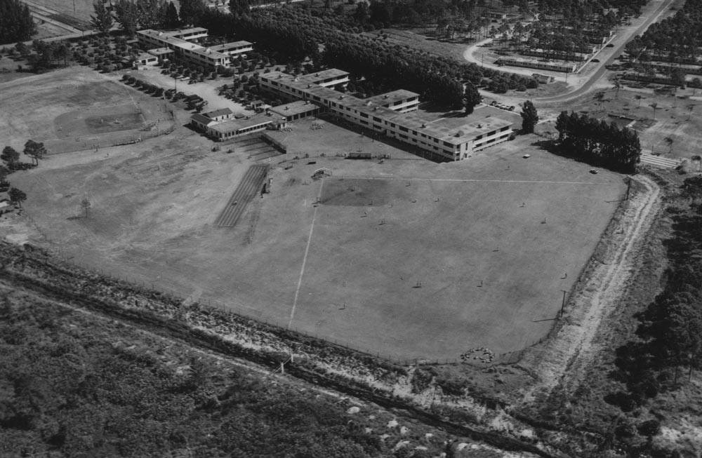 An aerial view of Historic Dodgertown, circa the mid 1950s. In the foreground is Field No 1 and Field No 2 to the far left. In the background are the former Naval Air Station barracks that in 1948, for the first time, provided integrated living and dining quarters at a Spring Training site in the South as ordered by the Brooklyn Dodger co-ownership of Branch Rickey, Walter O'Malley, John Smith and Dearie McKeever Mulvey.