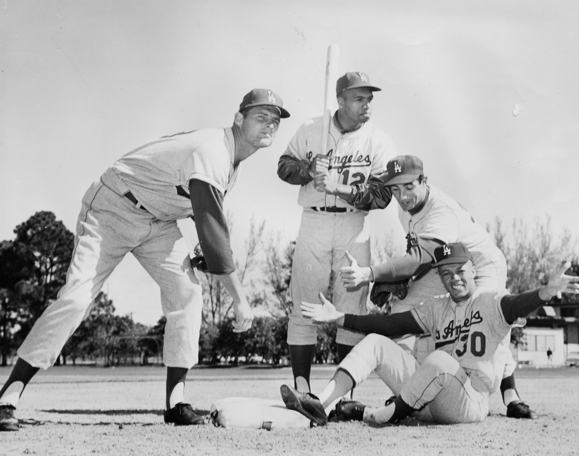 "(L-R) Don Drysdale; Tommy Davis; Sandy Koufax; Maury Wills.  These four Dodgers were performance leaders for the Dodgers' great play from 1959 to 1965 where they won three World Championships in 1959, 1963, and 1965.  In 1962, Drysdale won the Cy Young Award, Tommy Davis was the National League batting champion, and Maury Wills won the 1962 National League Most Valuable Player Award.  In 1963, these four players were part of the 1963 World Champion Dodger team that swept the New York Yankees in four games.  In 2005, Tommy Davis stated in an autobiographical book, ""Tales from the Dodger Dugout,"" that he signed a professional contract with the Dodgers because Jackie Robinson called Davis and gave him his strongest recommendation the Dodgers would the best team for Davis to play."