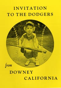 "A young Dodger fan from Downey, California wears her ""LA"" cap and tries to bunt her way on to convince Walter O'Malley to locate a new baseball stadium in that city. The photo was on the cover of a printed document entitled ""Invitation to the Dodgers from Downey, California."""