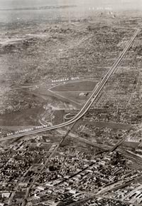 An aerial photo from the Fletcher Aviation Corporation offers available land for the Dodgers to build a baseball stadium in the city of El Monte. The particular site for the Stadium is outlined just off the San Bernardino Freeway.