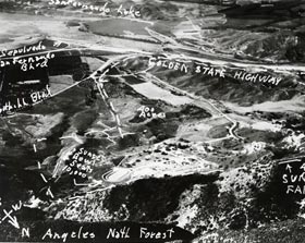 "An aerial photo of land in North Hollywood near the Angeles National Forest is proposed by someone for the location of a new baseball stadium in Southern California. The person submitting the location said the land was a mixture of granite and clay that could easily be moved to form a ""natural"" bowl for a baseball stadium."