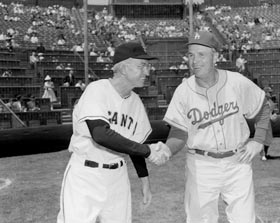 The first major league game on the West Coast was played at Seals Stadium in San Francisco on April 15, 1958. Dodger Manager Walter Alston shakes hands with Giants Manager Bill Rigney prior to that historic game. Rigney was unable to pilot the Giants for the first game in Los Angeles on April 18, as he was ill and remained in an Oakland hospital, giving way to Coach Herman Franks.