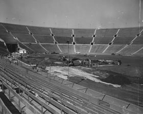 Construction is underway at the Los Angeles Memorial Coliseum early in 1958 to prepare a baseball diamond on the playing surface, previously used primarily for football and track & field events. The oval-shaped Coliseum presented numerous challenges for Dodger owner Walter O'Malley, but he resolved them at their temporary home, while designing, building and privately-financing Dodger Stadium.