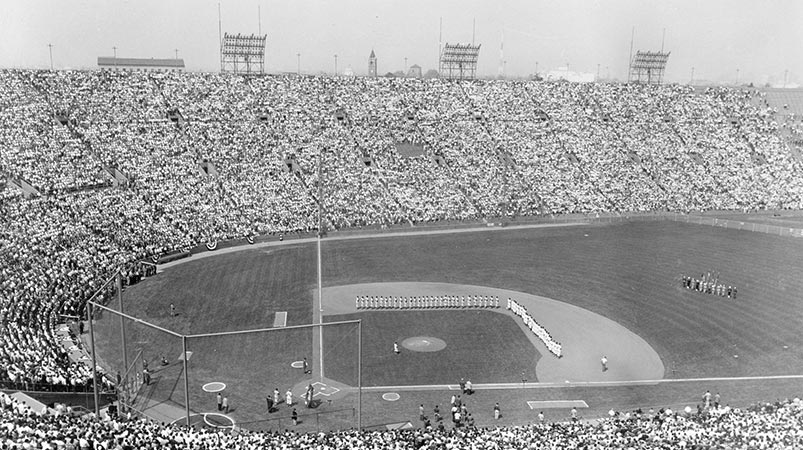 This view shows the enormous crowd of 78,672 at the Los Angeles Memorial Coliseum during player introductions for the first Dodger game in Los Angeles on Friday, April 18, 1958. The Dodgers defeated the San Francisco Giants, 6-5.