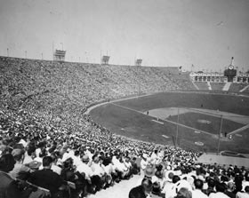 An Opening Day record crowd of 78,672 attends the first major league game in Los Angeles history between the Dodgers and the San Francisco Giants at the Los Angeles Memorial Coliseum, April 18, 1958.
