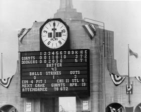 A view of the Los Angeles Memorial Coliseum scoreboard on April 18, 1958 at the first major league game in Los Angeles shows a record attendance of 78,672.