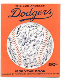 The inaugural Los Angeles Dodgers Yearbook cover of 1958 depicts the facsimile autographs of the players and Manager Walter Alston.