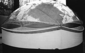 "The concept for O'Malley's translucent dome stadium in Brooklyn ""was to be supported by a lightweight aluminum truss structure some 300 feet above the pitchers mound, high enough to cover a 30-story building."" It would have enabled sunlight to shine through, much the same as a greenhouse."