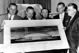 Walter O'Malley, President of the Dodgers, reviewed the proposed Harris County Sports Stadium, better known later as the Houston Astrodome, on October 18, 1960 when the National League owners voted to grant Houston and New York franchises. Along with O'Malley at the meeting were (left to right) Robert Carpenter, Phillies owner; Gabe Paul, Reds General Manager; Phil Wrigley, Cubs owner; and Joe L. Brown, Pirates General Manager.