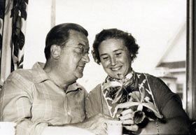 """Walter and Kay O'Malley at the family greenhouse in Amityville, New York, where the Dodger President enjoyed spending time cultivating exotic orchids. O'Malley likened the concept of a translucent dome stadium to that of the """"interior effect of the sort one finds in a greenhouse."""""""