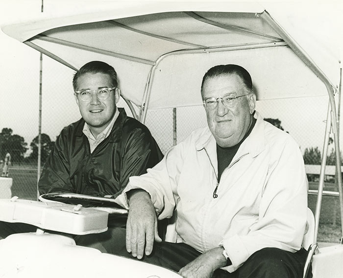 (L-R) Peter O'Malley; Walter O' Malley. Peter O'Malley, the President of the Los Angeles Dodgers and Walter O'Malley, the Chairman of the Board of the Los Angeles Dodgers, are seen in a 1970s photo on a day at Dodgertown in Vero Beach, Florida. Walter O'Malley was one of four Dodger co-owners when Dodgertown opened in 1948. It would be Walter and Peter O'Malley who would later modernize Dodgertown, including new villas for living quarters and a nine-hole and 18-hole golf course. In 1962, Peter O'Malley was the Dodgertown Camp Director who integrated Holman Stadium for all fans.