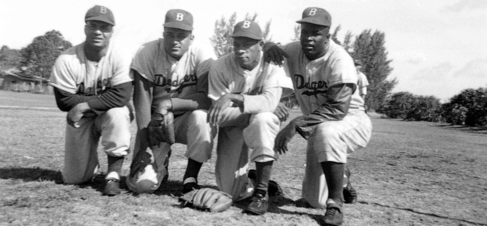 (L-R) Roy Campanella; Don Newcombe; Dan Bankhead; Jackie Robinson. Four record setting African-American Dodgers are at Dodgertown in the early 1950s. Roy Campanella won three National League Most Valuable Player Awards and was elected to the Hall of Fame in 1969. Don Newcombe was the only player in major league history to win the Rookie of the Year, the Cy Young Award and the National League Most Valuable Player Award. Dan Bankhead was the first African-American pitcher to appear in a major league game and hit a home run in his first at bat. Jackie Robinson won the first National League Rookie of the Year in 1947, the Most Valuable Player Award in 1949 and was elected to the Hall of Fame in 1962.