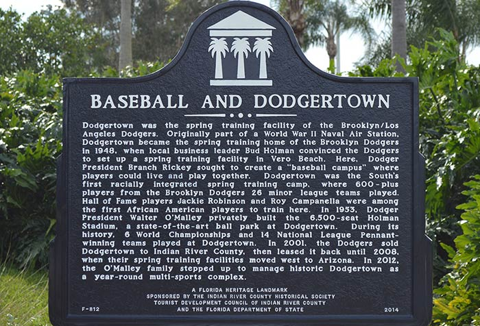 """The Florida Heritage Landmark, dedicated at Dodgertown on November 10, 2014, tells the history of Dodgertown and its impact upon baseball and American civil rights.  Dodgertown was conceived by team President Branch Rickey and along with co-owners Dearie Mulvey, Walter O'Malley, and John L. Smith, determined the Spring Training base would be integrated for all players.  The Dodgers would hold their Spring Training at Dodgertown through the 2008 season. The site continues to function today as """"Historic Dodgertown,"""" a multi-sport training and conference center."""