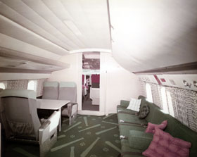 The Electra's exclusive baseball bat and ball carpet design is shown in color in this interior cabin photograph of the forward lounge and cockpit. Horton and Horton of Ft. Worth, Texas ordered the 113-foot long carpet (15-foot wide) in one piece from Brazil.