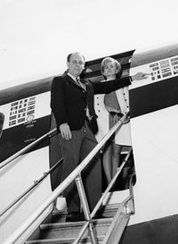 Bump Holman, who retired after the 1964 season to carry on his father's businesses in Vero Beach, Florida, selected former Eastern Air Lines pilot Lew Carlisle to take the controls of the Dodger Electra II in 1965. Beginning in 1971, Carlisle piloted the Dodgers 720-B fan jet. Carlisle and his wife Millie are ready to enter the plane.