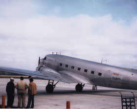 In 1950, the Dodgers acquired a DC-3 from Eastern Air Lines President Capt. Eddie Rickenbacker. The DC-3 replaced the Twin Beechcraft that former Dodger President Branch Rickey used to fly around Florida and to and from New York to Vero Beach, Florida for Spring Training. Bud Holman is visible looking at the plane, standing on the far right.