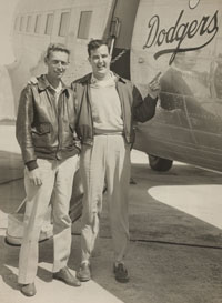 Bump Holman stands in front of the DC-3 with Lee Pike, his first flight instructor and first co-pilot with the Dodgers in 1954. Holman got his commercial pilot's license at the age of 18.