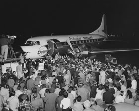 """The Dodger Convair 440 arrives in Los Angeles for the first time on October 23, 1957 carrying club executives and select players as the welcoming committee and fans are ready to greet the Dodgers to their new home. Bump Holman had """"Los Angeles"""" painted on the plane in Vero Beach, Florida prior to traveling to New York to pick up the traveling contingent and flying to Los Angeles. The Dodgers arrived more than two hours late for the festivities due to strong headwinds which necessitated a fuel stop by Capt. Holman, but it did not put a damper on the celebration as the bands played and the big crowd properly welcomed the traveling party."""