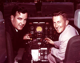 Capt. Bump Holman and co-pilot Paul Loux are beginning preparations for another road trip inside the cockpit of the Dodger Convair 440 Metropolitan, which went into service during Spring Training, 1957.