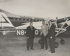 In 1959, Capt. Bump Holman prepares to take Dodger President Walter O'Malley and his son Peter to Miami in a Piper Tri-Pacer. Behind the Piper is the Los Angeles Dodgers Convair 440 Metropolitan airplane.