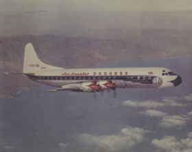 Lockheed mocked up a color photograph of their Electra II showing what the specialized Dodger airplane would potentially look like, using the same markings and colors as the Dodger Convair 440 Metropolitan. The Dodgers began using the Electra II in 1962 with Capt. Bump Holman at the controls.